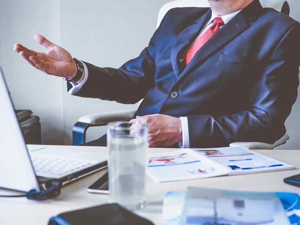 mistakes even bosses make, harlingen staffing agency, staff force, man in suit sitting behind desk