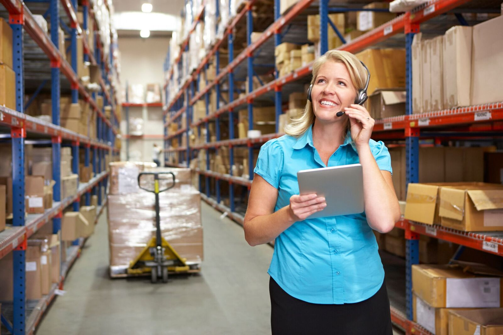 importance of customer service skills, austin employment agency, staff force, woman on phone in warehouse